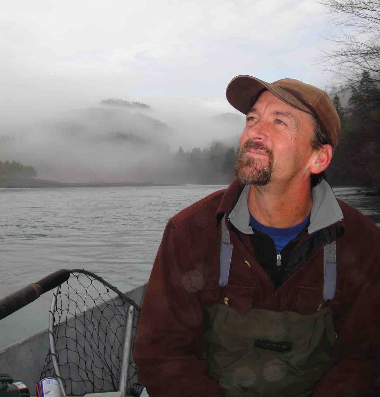 Rogue river fishing guide enjoying a morning on the Elk river from the comfort of his drift boat.