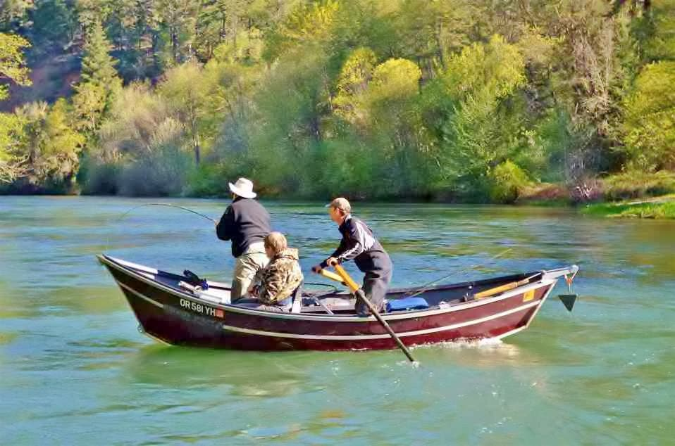Guided fishing trip from a drift boat on the Rogue river, Oregon.